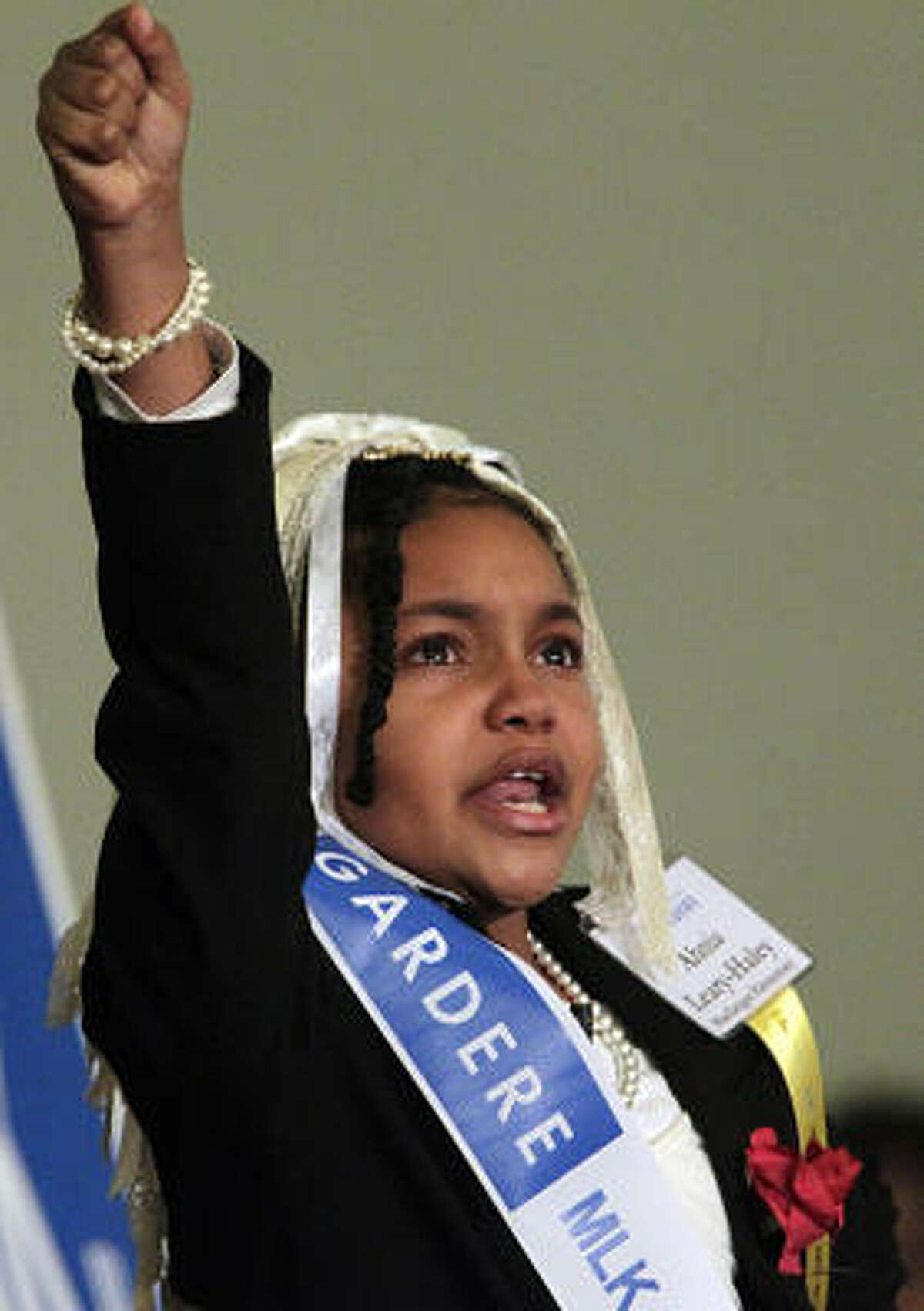 Ahnia Leary-Haley's , 4th grader at MacGregor Elementary School, delivers her speech.