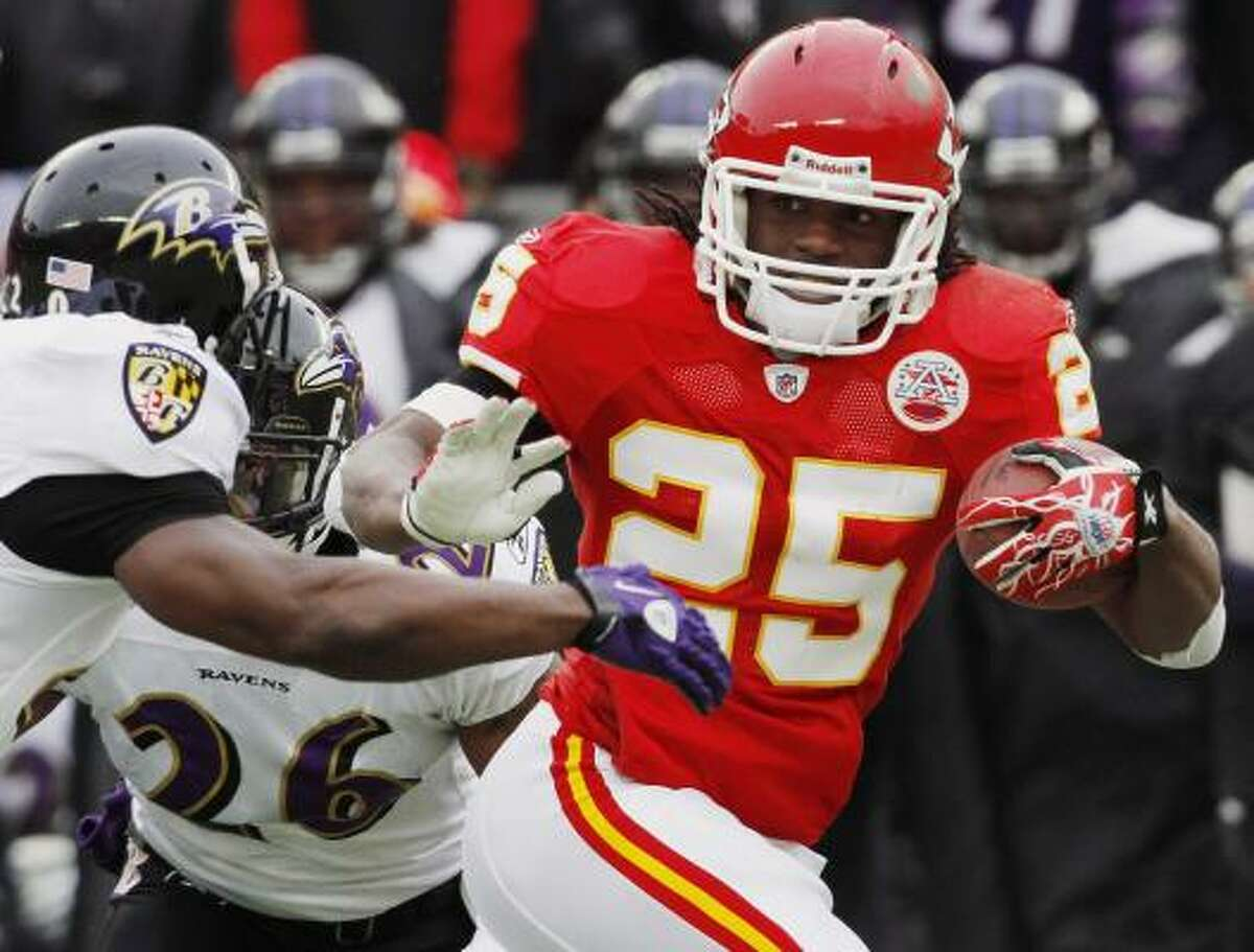 Chiefs running back Jamaal Charles pushes Ravens safety Ed Reed away on his way to a 41-yard touchdown.