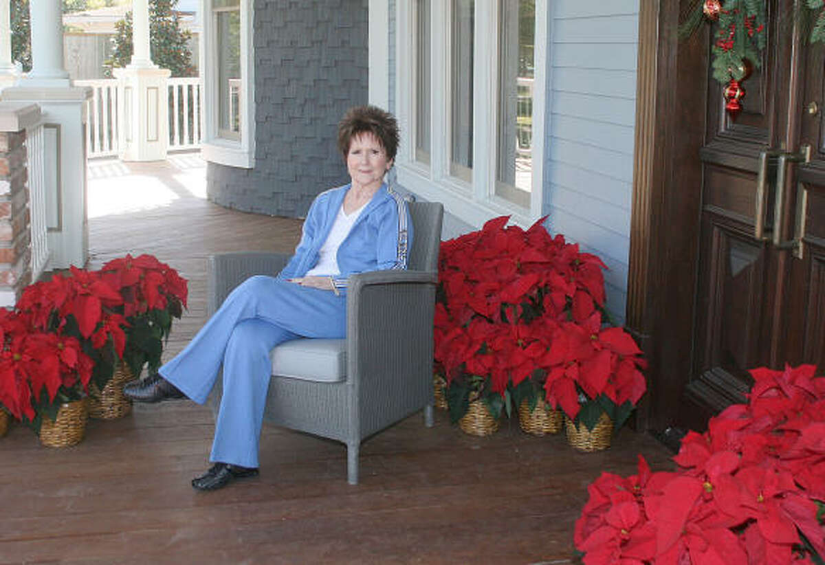 Patti Worthington sits on her porch in 2008, in a publicity photo for the Historic Houston Heights Holiday Home Tour. Her home was on the tour.