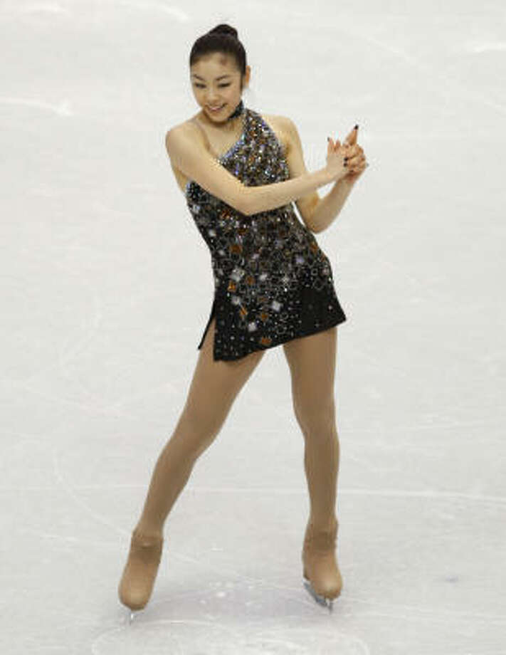 Kim Yu-Na skates to music from the James Bond movies. Photo: Paul Chinn, The Chronicle