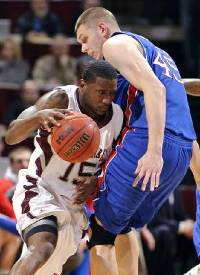 Texas A&M's Donald Sloan is third in the Big 12 in scoring with 18.8 points per game. Photo: Dave Einsel, AP