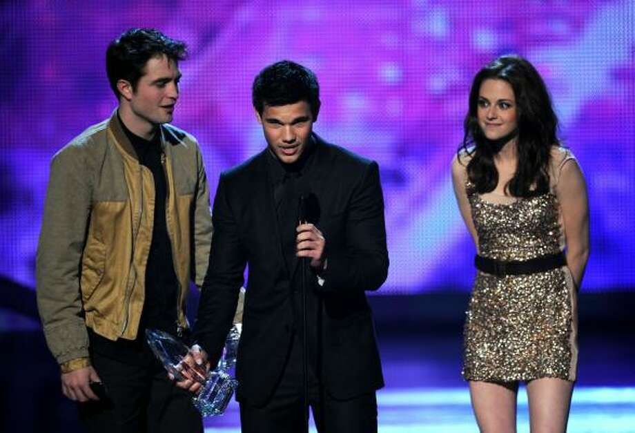 Favorite Movie The Twilight Saga: Eclipse Robert Pattinson, Kristen Stewart and Taylor Lautner accepting Photo: Kevin Winter, Getty Images