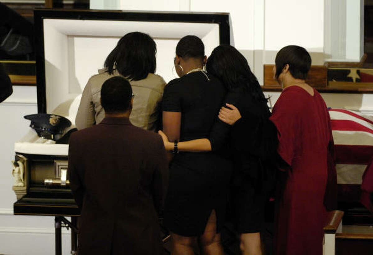 Mourners pass the open casket of Officer Jillian Smith during the memorial service at Mount Olive Baptist Church in Arlington, Texas.