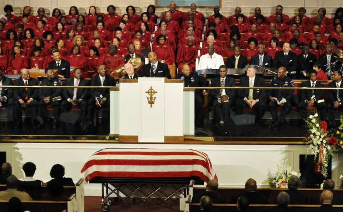 Rev. James P. Thompson, Jr. delivers the eulogy during a memorial service for Jillian Michelle Smith at Mount Olive Baptist Church in Arlington, Texas.