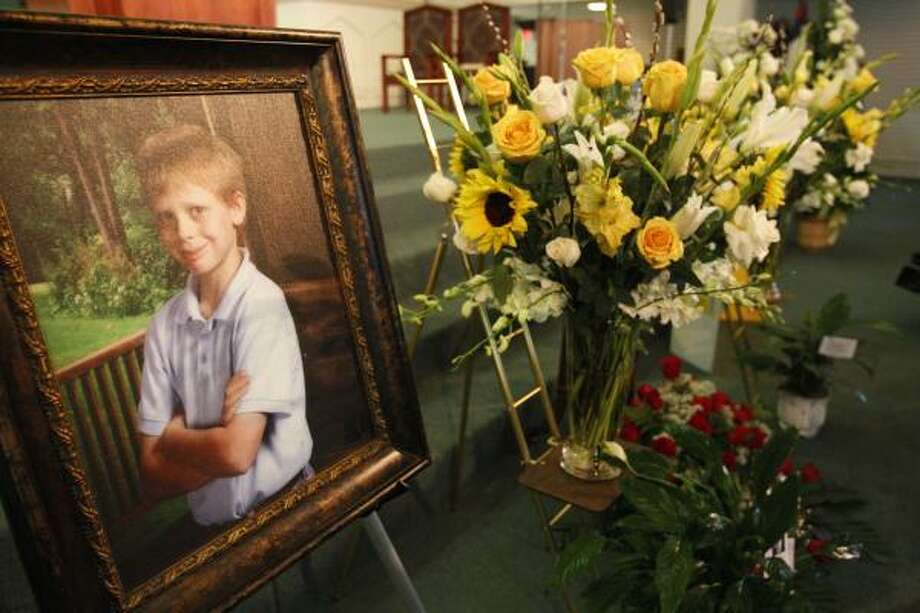 As visitors started trickling into a Garden Oaks church to pay their respects to 12-year-old Jonathan Foster Jan. 4, 2011, family members held a brief press conference requesting a day of remembrance for a sweet, trusting boy. Photo: Melissa Phillip, Chronicle
