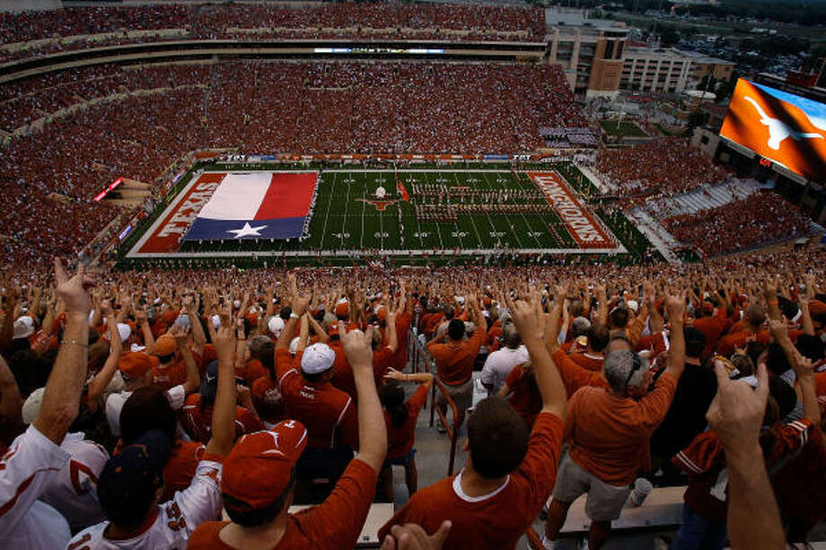 The crowds that jam Royal-Texas Memorial Stadium help contribute to the fact that Texas beats its nearest competitor in football-generated revenue by almost $20 million. Photo: Ronald Martinez, Getty Images