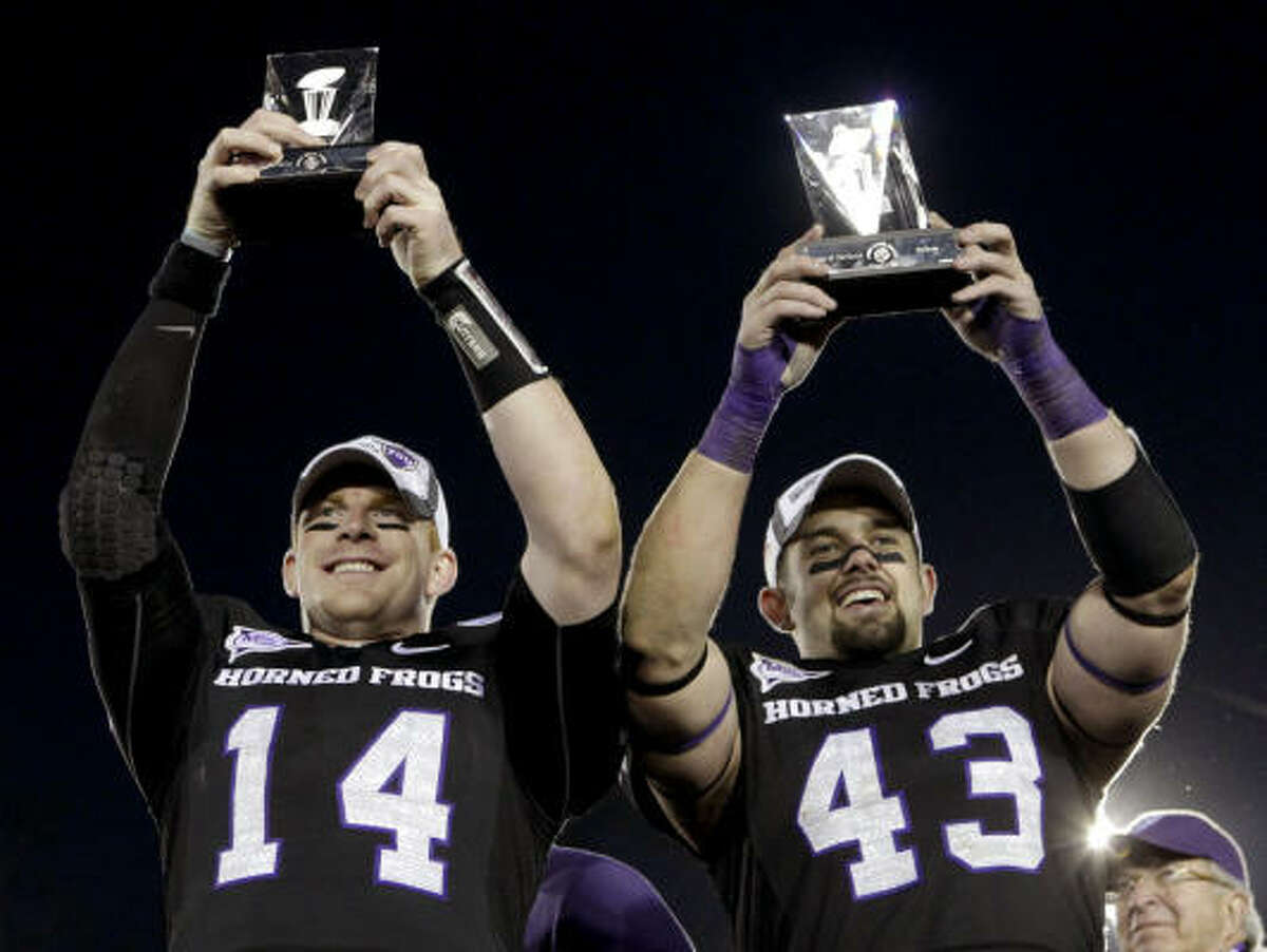 TCU quarterback Andy Dalton, left, was named the Rose Bowl's offensive MVP, and linebacker Tank Carder was the defensive MVP.