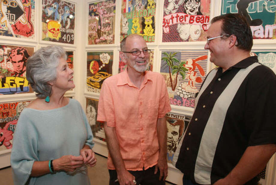 Betty Moody, from left, Michael Miller and Joe Daun in front of an exhibit of Miller's work at Moody Gallery. Photo: Gary Fountain, For The Chronicle