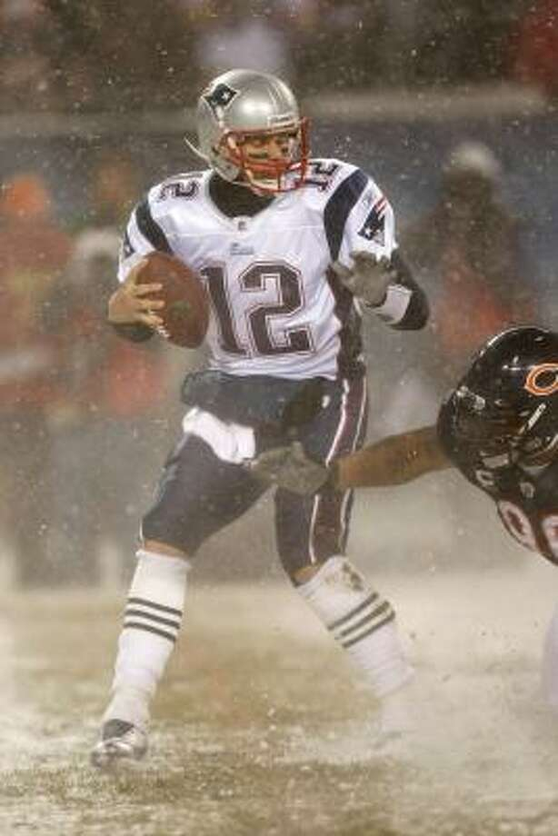 Tom Brady's consistency and wins over teams with winning records earned him at least one MVP vote. Photo: Scott Boehm, Getty Images
