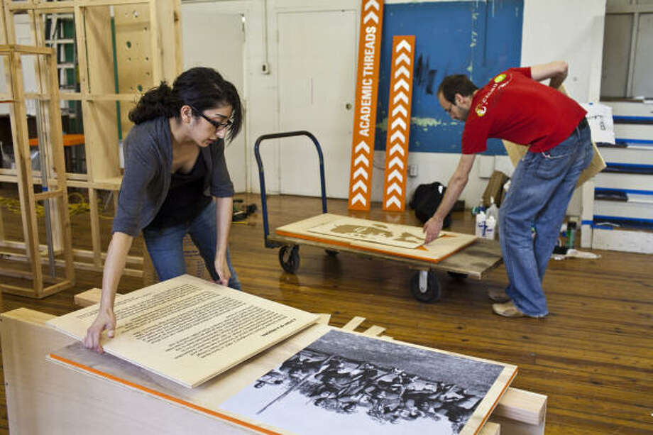Christina Zeibak, a UH architecture student, and Danilo Bojic, a UH graphic communications grad student, are helping to develop a museum out of what had previously been a storage room. The museum reveals the history of the Third Ward, where the school is located. Photo: Eric Kayne, For The Chronicle