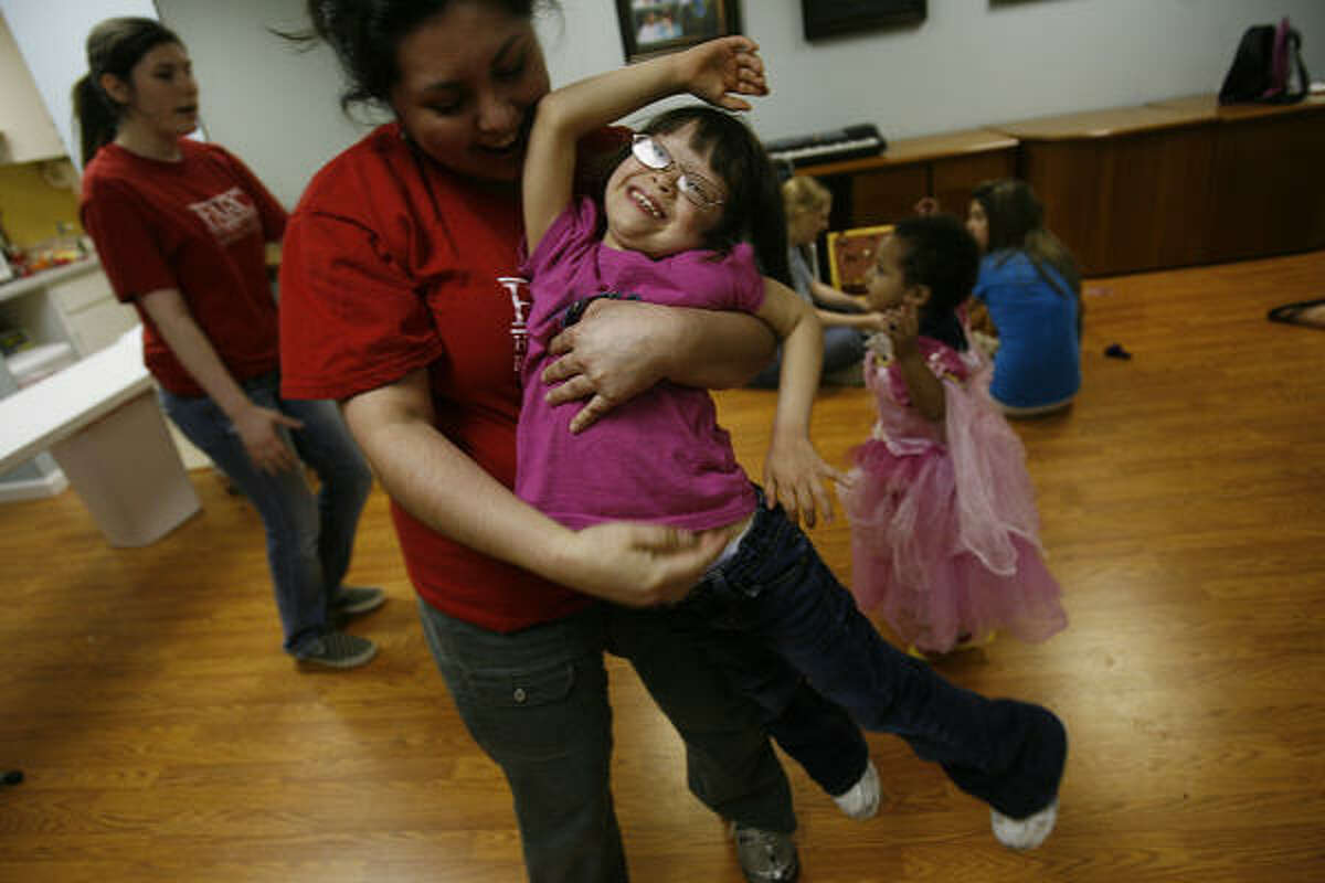 Rebecca Lucio is among the staffers at Houston Area Respite Center who look after special-needs children like Kiana Fanduiz, 5, giving parents what is sometimes the only break they get.