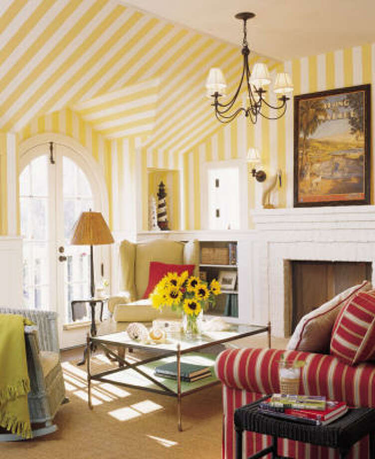 EYEING angleS: Wallpapered with stripes of sunshine overhead, a sitting room radiates warmth all winter.