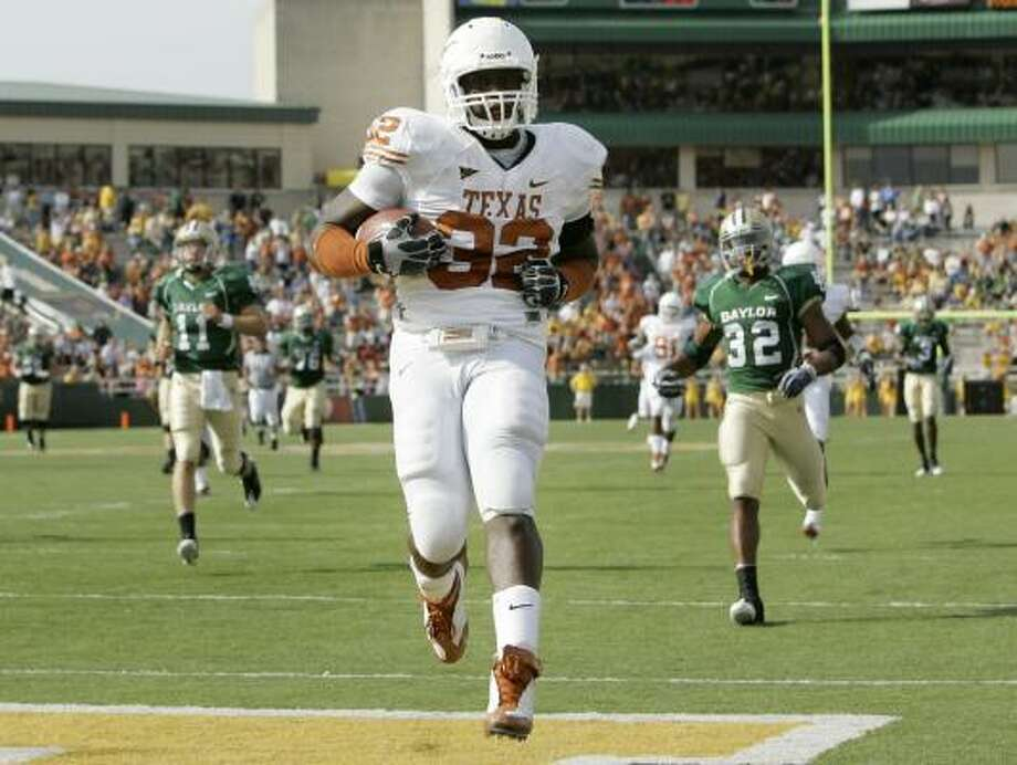 Eddie Jones returned an interception for a score, the Longhorns' 10th non-offensive touchdown this season. Photo: Tony Gutierrez, AP
