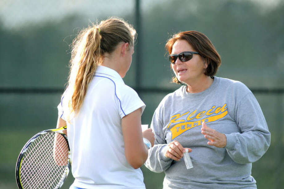 Klein tennis coach Holly Cannon talks to one of her players during a match last year. Photo: Chronicle File Photo