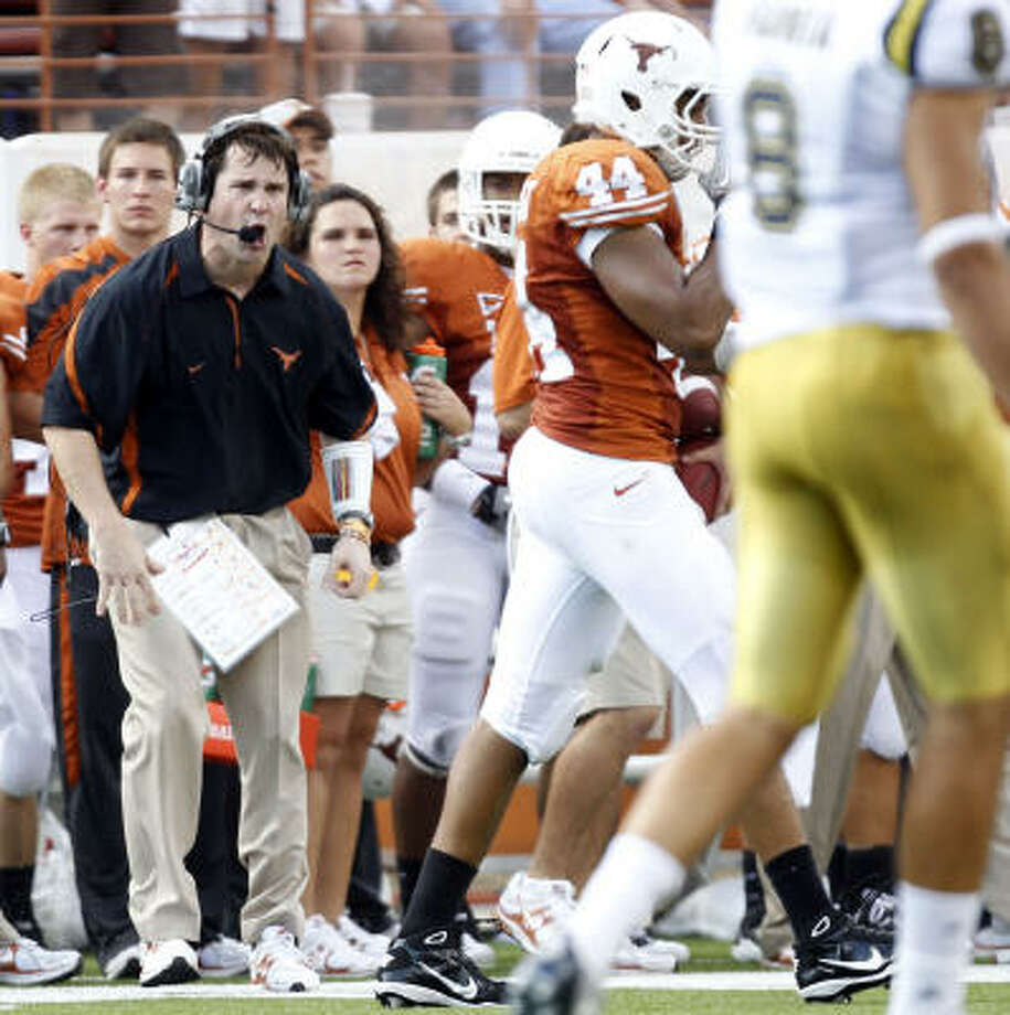 Texas defensive coordinator Will Muschamp, left, has accepted an offer to be the head coach at Florida. Photo: VERNON BRYANT, DALLAS MORNING NEWS