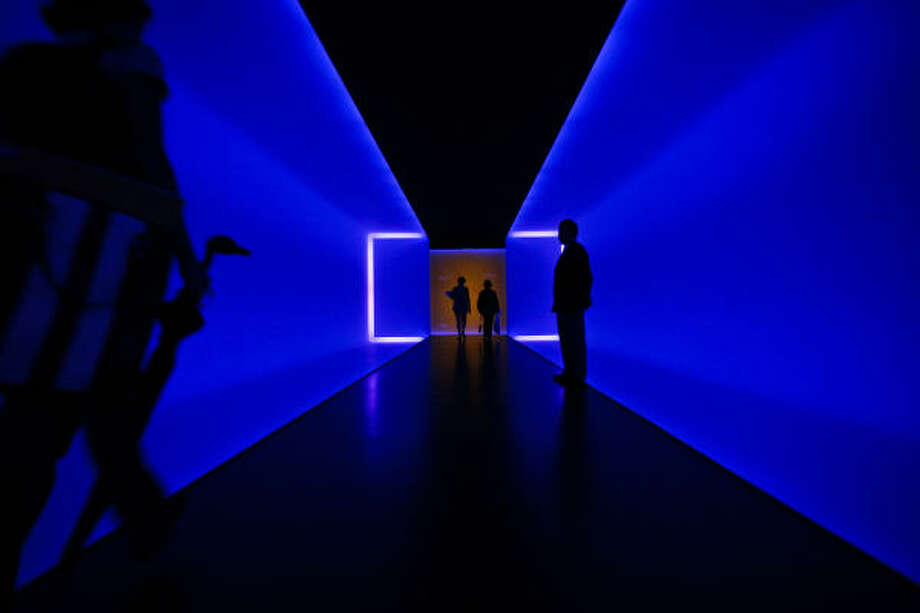 Museum goers walk through James Turrell's The Light Inside installation, which is located in the tunnel that connects the Beck and Law buildings at the Museum of Fine Arts, Houston. Photo: Michael Paulsen :, Chronicle