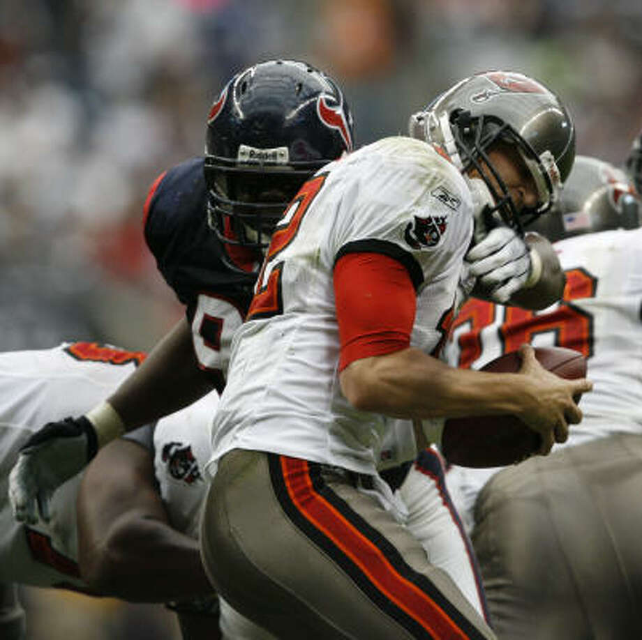 Earl Cochran and the Texans picked up four sacks on Sunday to three for the Bucs. Photo: Kevin Fujii, Chronicle