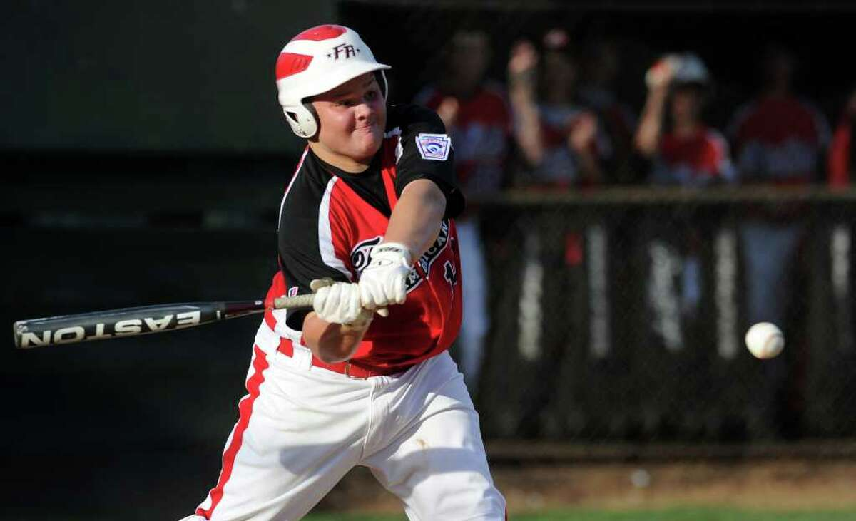 Eddie Schwartz hits a single during Wednesday's Fairfield American Little League Section 1 Championship game against East Haven in Orange on July 27, 3011.
