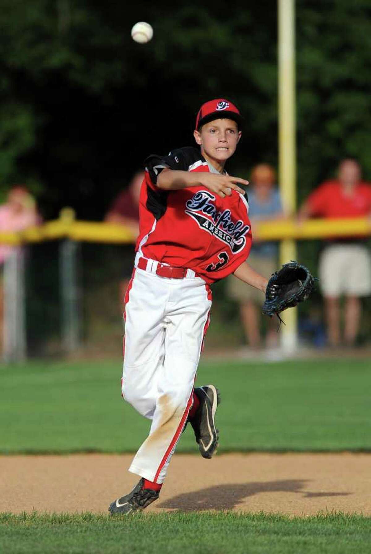 Philip Vlandis throws the ball during Wednesday's Fairfield American Little League Section 1 Championship game against East Haven in Orange on July 27, 3011.