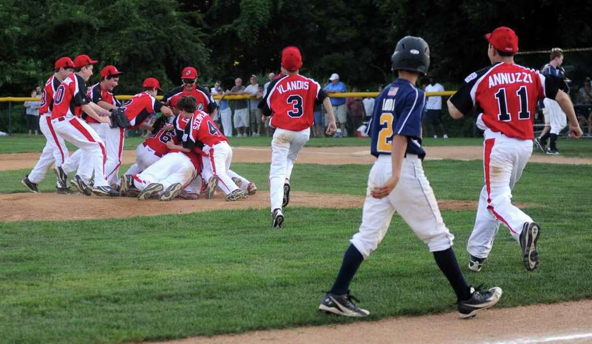 Fairfield American players celebrate their win after Wednesday's Fairfield American Little League Section 1 Championship game against East Haven in Orange on July 27, 3011.
