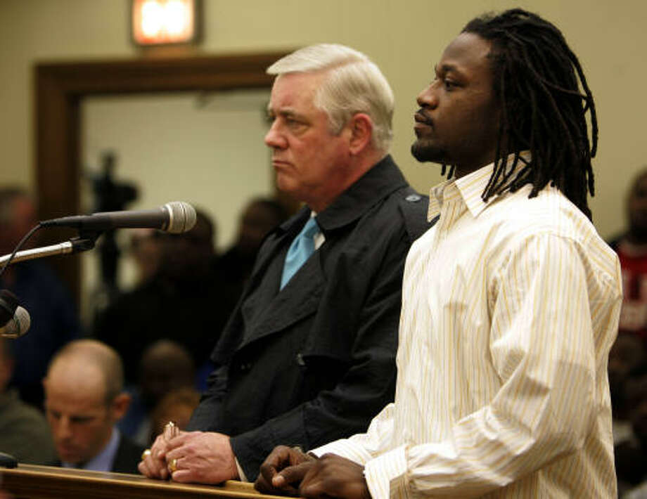 "Tennessee cornerback Adam ""Pacman"" Jones, left, listens with his lawyer Roger May during a court appearance Jan. 11 at Murfreesboro, Tenn., in which Jones was told he will see public intoxication and disorderly conduct charges against him dismissed if he behaves over the next six months. Jones is one of the reasons the NFL is seeking to strengthen its personal conduct policy. Jones has been involved in 10 incidents with the police since he was drafted in 2005. Photo: Dipti Vaidya, AP"