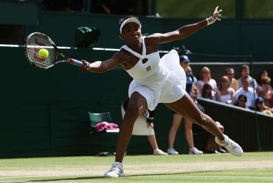 Venus Williams takes advantage of her lengthy limbs on a reaching forehand return. Photo: Ryan Pierse, Getty Images