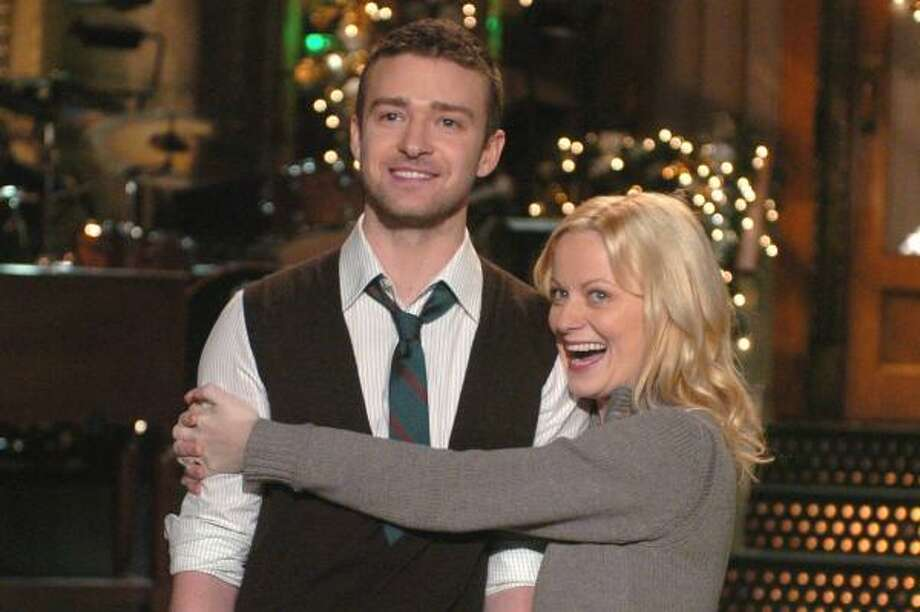 Amy Poehler hugs Justin Timberlake during a taping of Saturday Night Live. Photo: DANA EDELSON, NBC | ASSOCIATED PRESS