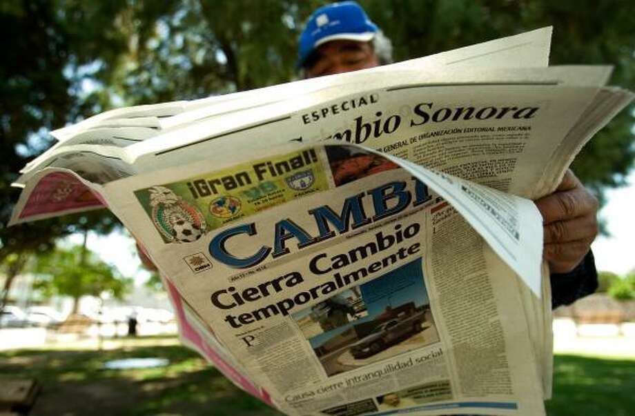 A man reads the last edition of the newspaper Cambio in Hermosillo, Mexico, on Friday. Over the last few weeks, the newspaper's offices had been the scene of a couple of attacks. Photo: Guillermo Arias, AP