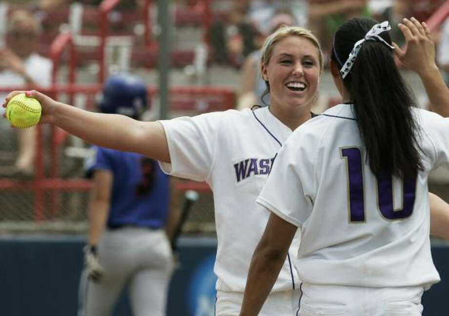 Washington's Danielle Lawrie, left, enjoys the completion of her no-hitter with Nicole Moojen. Photo: ASSOCIATED PRESS