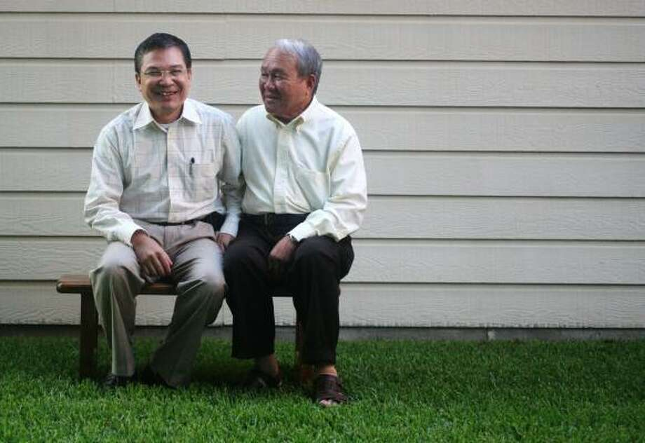 Son Pham, left, did not get out of North Vietnam when his extended family fled South Vietnam three decades ago. He pines to live near his father, Khoung, right, in Houston. But proposed changes in U.S. immigration law could prevent that from happening. Photo: BILLY SMITH II PHOTOS, CHRONICLE