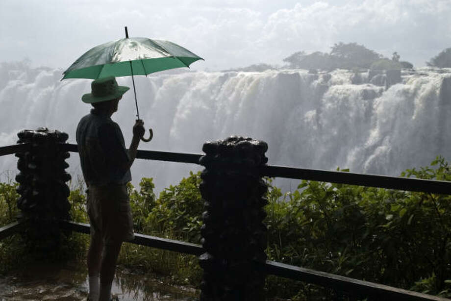 Zambia's thundering Victoria Falls thrills sightseers and adventure travelers alike. Photo: Emily Riddell, Lonely Planet Images