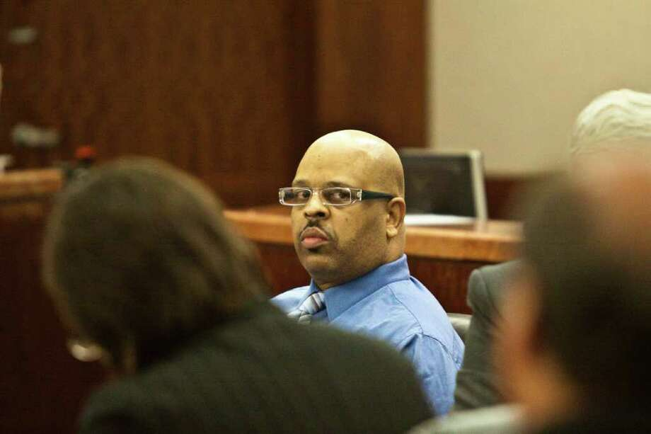 The trial of Theron Owens, in blue, begins July 27, 2011 in Houston. A former New Orleans police officer, in an interview with Quanell X, Owens confessed to hacking up his mother and grandmother during a 2008 argument  (Eric Kayne/For the Chronicle) Photo: Eric Kayne / © 2011 Eric Kayne