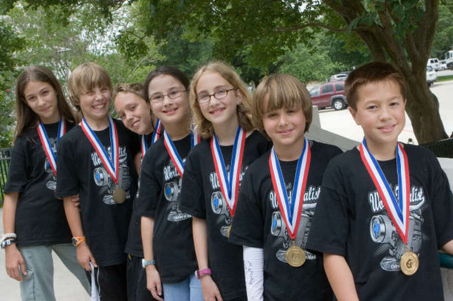 The River Oaks Elementary School team of fifth-graders that secured a victory at the Odyssey of the Mind world championship is comprised of, from front, Gregory Ross, Joseph Caplan, Sonia Margolin, Mikaela Juzswik, Jacob Hopkins, Daniel Treat and Helen Galli. Photo: R. Clayton McKee, For The Chronicle