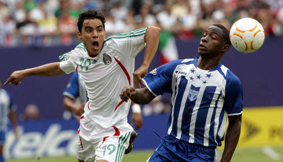 Omar Bravo, left, and Mexico and Maynor Figueroa and Honduras next play on Wednesday at Reliant Stadium. Photo: DON EMMERT, AFP/Getty Images