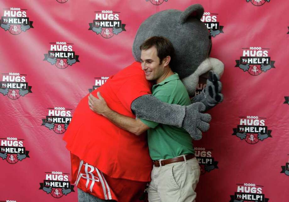 "7/27/11:  Rockets mascot, Clutch hugs Matt Berry, younger brother  of Joshua Berry at the Rockets benefit at Toyota Center in Houston, Texas.  The Rockets are launching a community initiative to benefit the children of Robin and Joshua Berry.  Rockets coach Kevin McHale will be part of it. Joshua and Robin Berry were killed in an automobile accident near Lubbock, TX on July 2, 2011 on their way back from a family vacation in Colorado. The accident resulted in spinal cord injuries to their two sons Peter, 9, and Aaron, 8, and also injured their daughter, Willa, 6. Peter and Aaron have been receiving treatment for spinal cord injuries at Children's Memorial Hermann Hospital in Houston since July 6. Willa received treatment for a broken arm and ankle and is now living with her aunt and uncle who have been appointed as the children's guardians. All proceeds collected during the campaign will be donated to the Joshua and Robin Berry Children's Trust fund that has been established by the family. Organizations or individuals interested in scheduling Clutch to make an appearance as part of the ""10,000 Hugs-to-Help"" campaign are asked to visit www.Rockets.com for more information. A complete and updated listing of Clutch's ""10,000 Hugs-to-Help"" tour stops is also available at www.Rockets.com. Clutch's 10,000 Hugs-to-Help Tour Stops:   For the Chronicle: Thomas B. Shea Photo: For The Chronicle:  Thomas B. Sh, Thomas B. Shea"