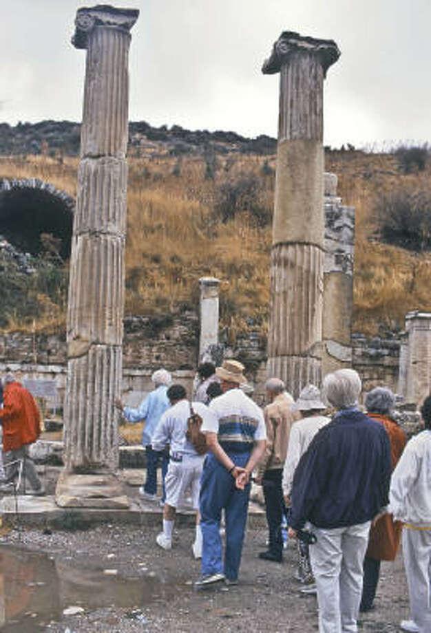 Visitors to Ephesus on Turkey's Aegean coast navigate the marble Roman columns. Photo: Anne Z. Cooke