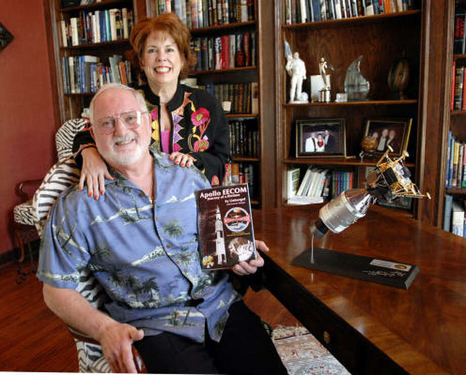 Sy Liebergot and his wife, Craig, pose in the library at their home with a copy of Sy's book, Apollo EECOM - Journey of a Lifetime. Photo: Kim Christensen, For The Chronicle