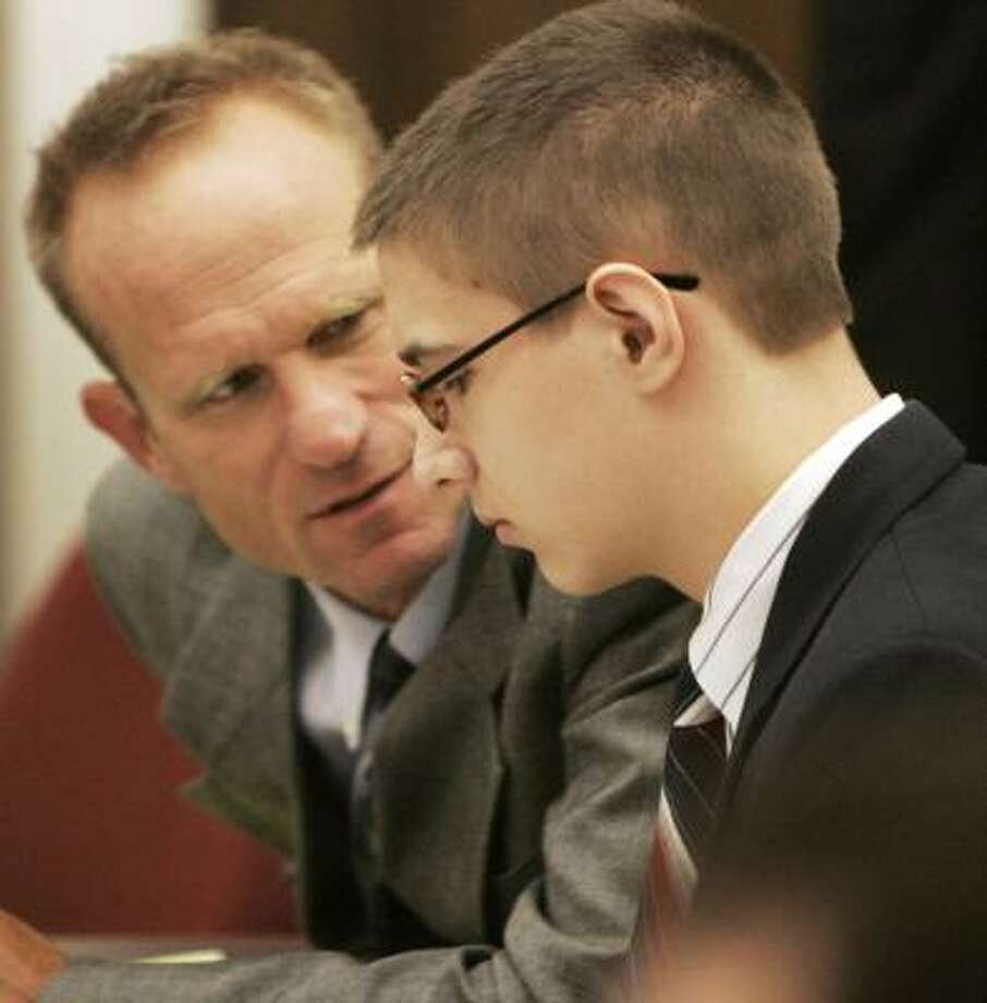 Eric Hainstock, 16, shown with assistant public defender Jon Helland during the teen's first-degree murder trial in Baraboo, Wis., on today, faces life in prison if convicted of killing his principal. Photo: Joseph W. Jackson III, Associated Press