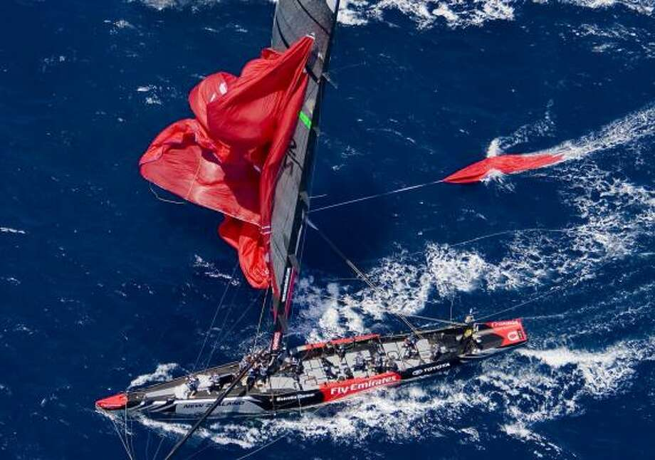 Emirates Team New Zealand sails with a ripped spinnaker in losing to Switzerland's Alinghi during race five of the America's Cup finals. Photo: CARLO BORLENGHI, ASSOCIATED PRESS