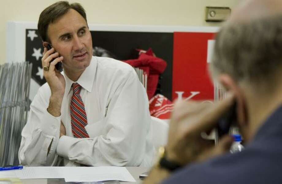 Pete Olson, the Republican candidate for District 22, mans the phones at the Fort Bend County GOP headquarters. Photo: Steve Ueckert, Chronicle