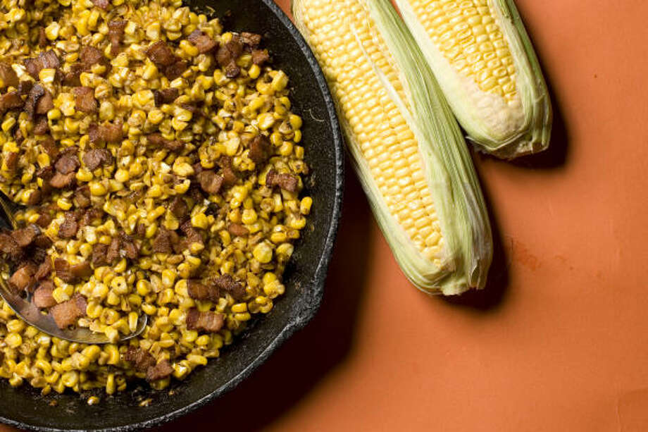 Crispy bacon and fresh corn make this recipe for Country-Fried Corn. Photo: Buster Dean, Chronicle