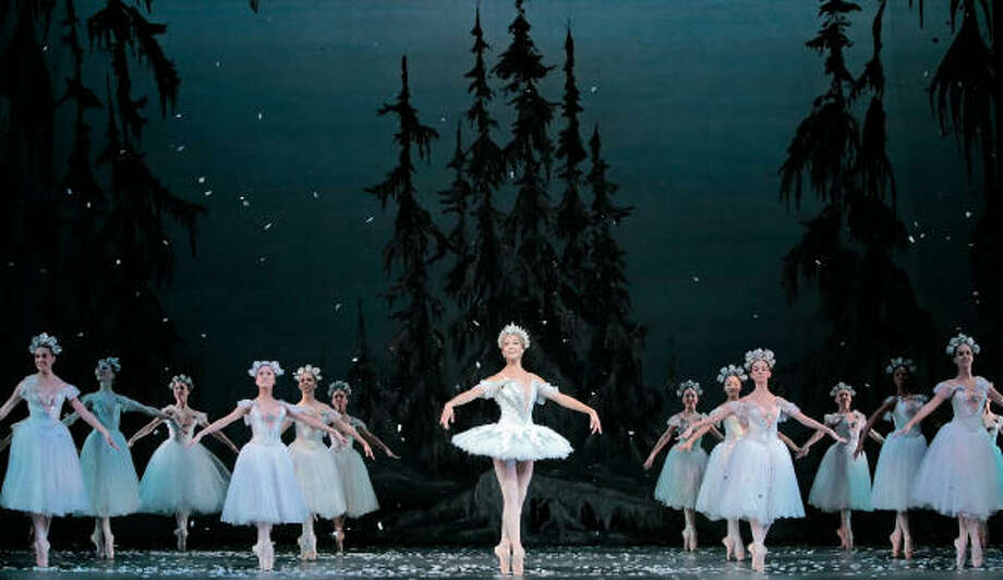 Houston Ballet's Jaquel Andrews wears a classical tutu as the Snow Queen while the Snowflakes wear romantic-style tutus. Photo: Jim Caldwell, Houston Ballet
