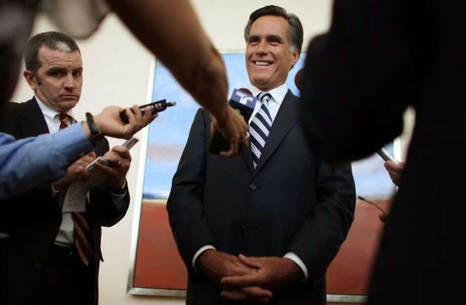 Presidential candidate Mitt Romney meets reporters after speaking to the Florida Medical Association where he put a conservative spin on health care reform, a popular Democratic issue. Photo: JOE RAEDLE, GETTY IMAGES