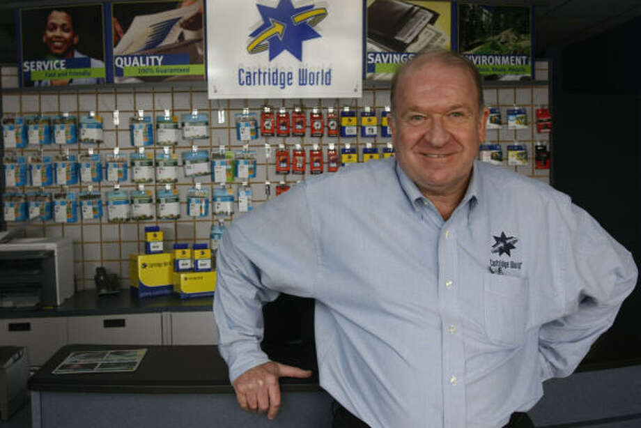 Patrick Le Feuvre, the franchise holder to Houston-area Cartridge World locations, is succeeding in a tough economy by providing savings for those needing printer ink. Photo: Julio Cortez, Chronicle