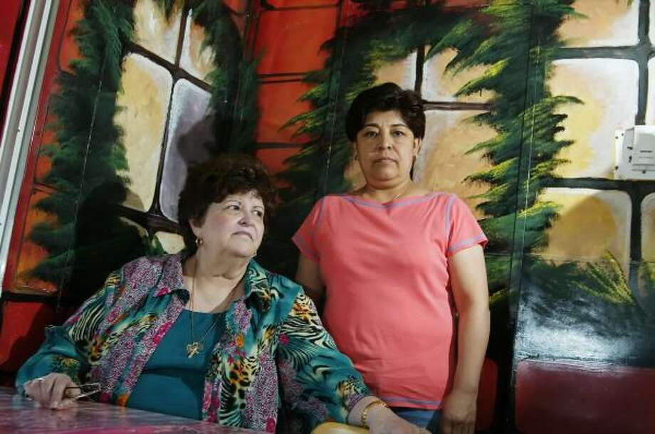 "Gloria Juarez, right, had to fire an employee of La Mexicana Y El Gringo, the restaurant she manages in Irving. ""It used to be real busy,"" said Beverly Vukovich, left, who eats there almost every day. Photo: BRANDON WADE, FOR THE CHRONICLE"