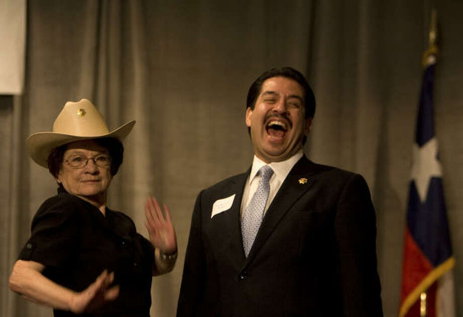 "NO SHRINKING VIOLET: Longtime City Secretary Anna Russell ""models"" her new hat Thursday after Harris County Sheriff Adrian Garcia made her an honorary deputy during a League of Women Voters luncheon at the Omni Hotel recognizing her decades of service. Photo: Sharon Steinmann, Chronicle"