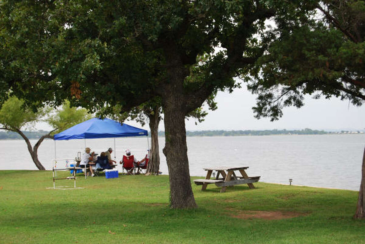 Picknickers enjoy the peaceful surroundings at Willow Point Resort in the town of Buchanan Dam.