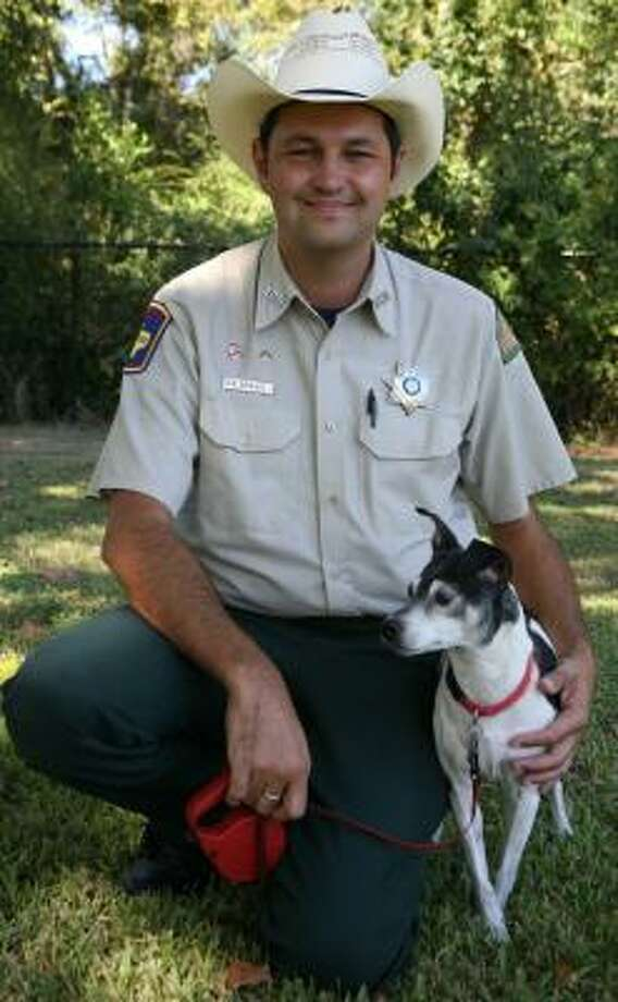 David Brown, Katy animal control officer, often brings his dog, Pepe, to work. Photo: SUZANNE REHAK, FOR THE CHRONICLE