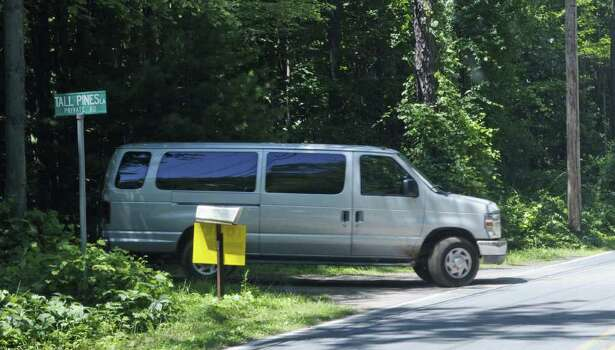 "A van is driven from Tall Pines Lane onto  Curry Road as film crews worked in the area  on Wednesday, July 27, 2011.  Crews were filming scenes for the movie ""The Place Beyond the Pines"".  (Paul Buckowski / Times Union) Photo: Paul Buckowski / 00014049A"