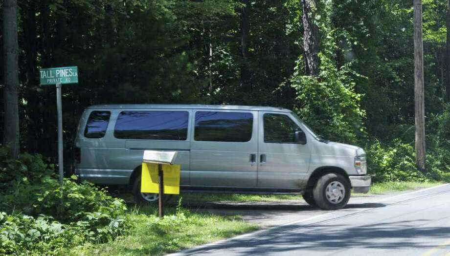 """A van is driven from Tall Pines Lane onto  Curry Road as film crews worked in the area  on Wednesday, July 27, 2011.  Crews were filming scenes for the movie """"The Place Beyond the Pines"""".  (Paul Buckowski / Times Union) Photo: Paul Buckowski / 00014049A"""